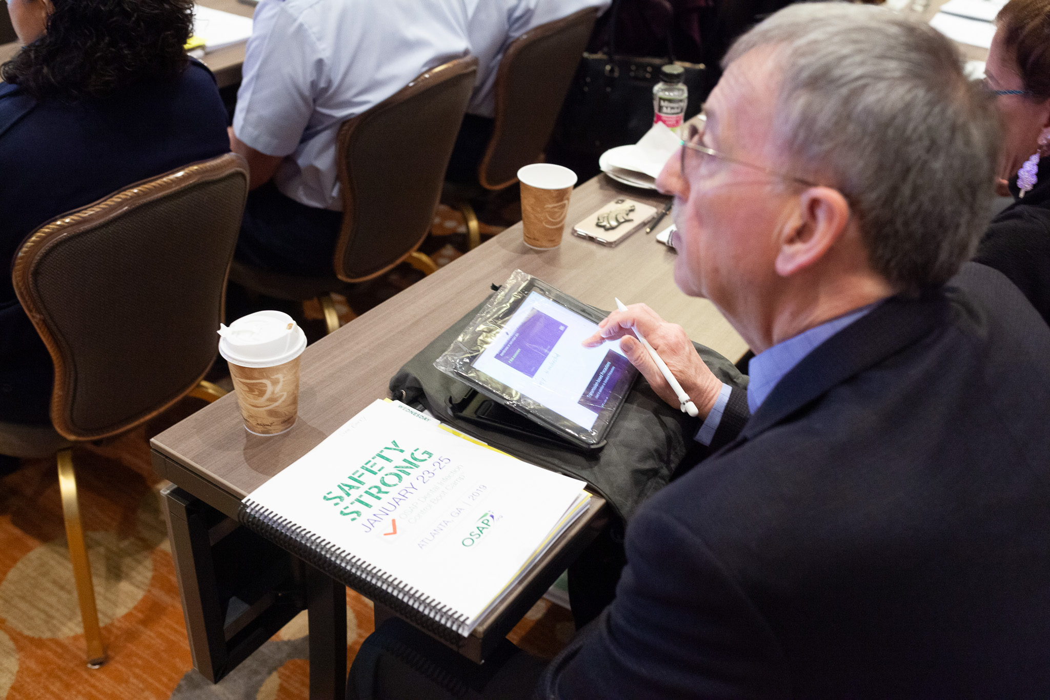 OSAP participant is pictured with his conference guide